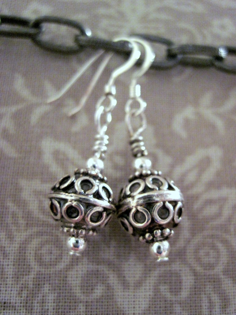 Sterling filigree balls.